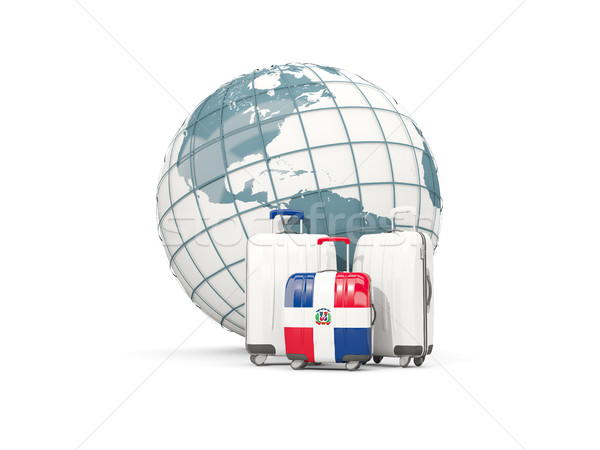 Luggage with flag of dominican republic. Three bags in front of  Stock photo © MikhailMishchenko