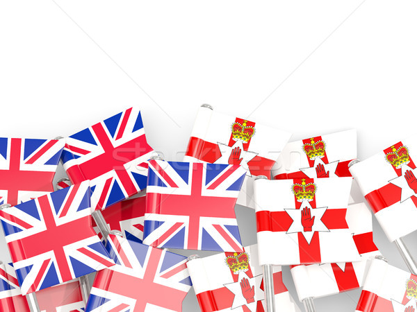 Stock photo: Flag pins of United Kingdom and Northern Ireland isolated on whi
