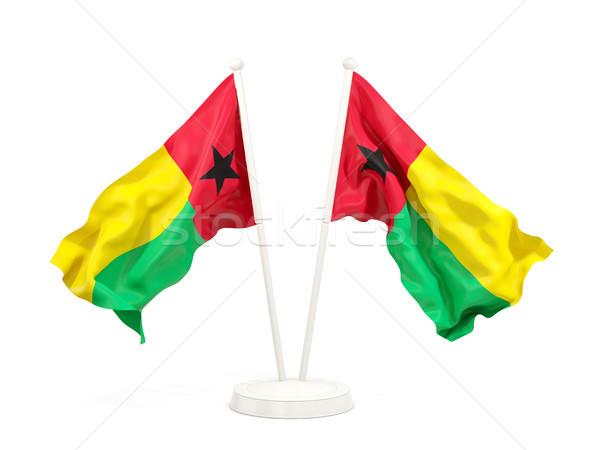 Two waving flags of guinea bissau Stock photo © MikhailMishchenko