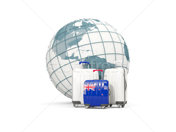 Luggage with flag of new zealand. Three bags in front of globe Stock photo © MikhailMishchenko