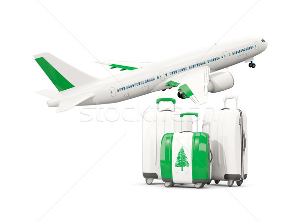Luggage with flag of norfolk island. Three bags with airplane Stock photo © MikhailMishchenko