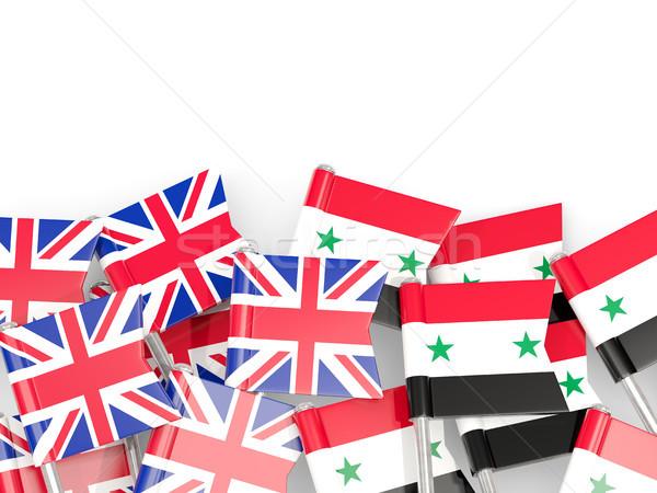 Flag pins of United Kingdom and Syria isolated on white Stock photo © MikhailMishchenko