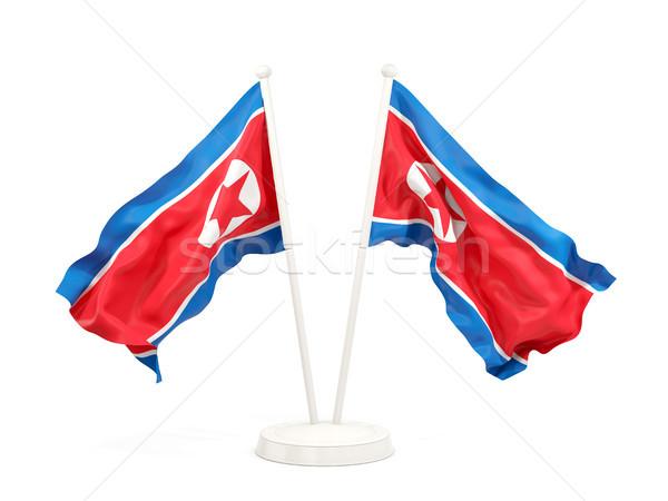 Two waving flags of north korea Stock photo © MikhailMishchenko