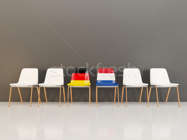 Chairs with flag of Germany and netherlands in a row Stock photo © MikhailMishchenko