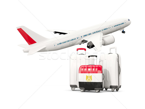 Luggage with flag of egypt. Three bags with airplane Stock photo © MikhailMishchenko