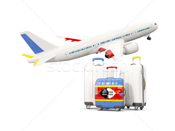 Luggage with flag of swaziland. Three bags with airplane Stock photo © MikhailMishchenko