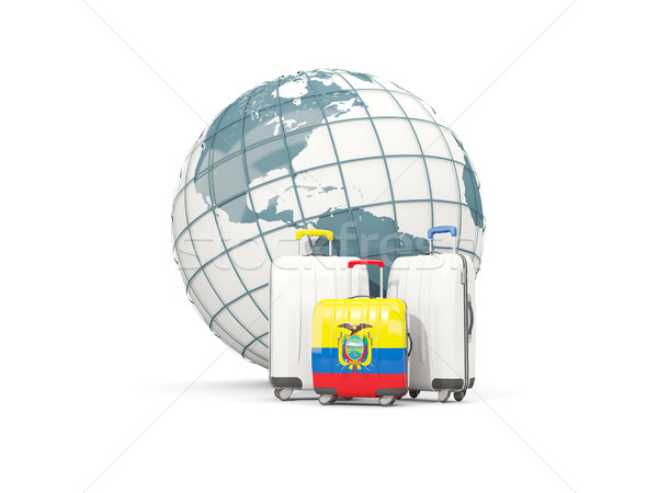 Luggage with flag of ecuador. Three bags in front of globe Stock photo © MikhailMishchenko
