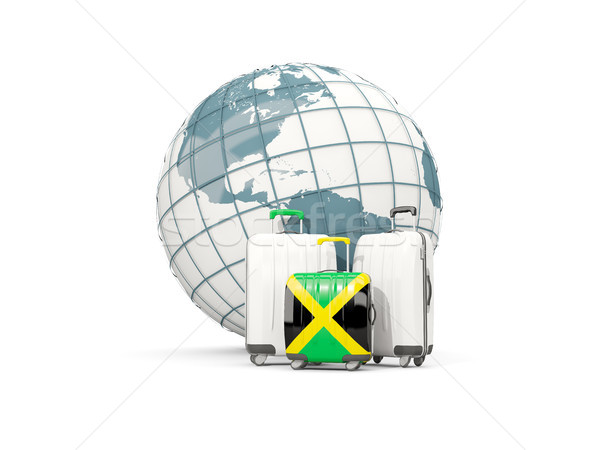 Luggage with flag of jamaica. Three bags in front of globe Stock photo © MikhailMishchenko