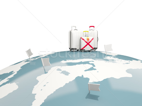 Luggage with flag of jersey. Three bags on top of globe Stock photo © MikhailMishchenko