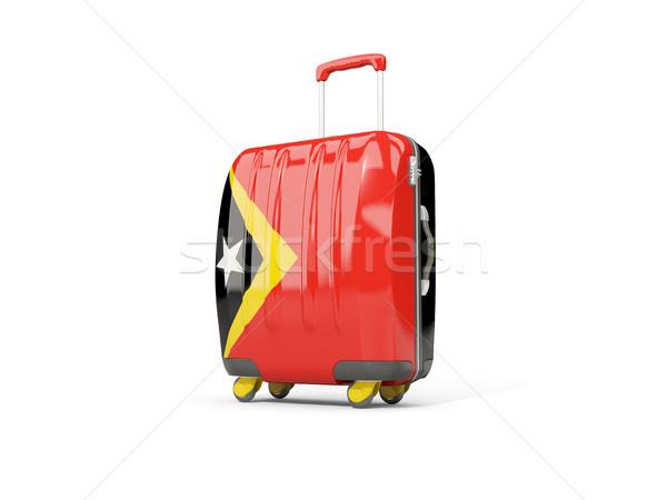 Luggage with flag of east timor. Suitcase isolated on white Stock photo © MikhailMishchenko