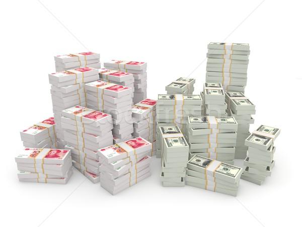 Stacks of dollars and chinese yuan Stock photo © MikhailMishchenko