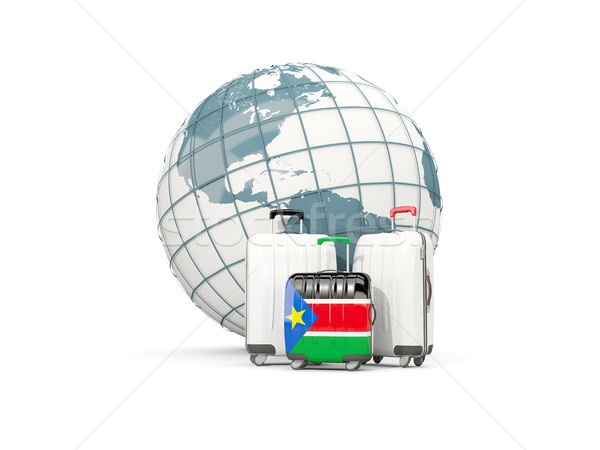 Luggage with flag of south sudan. Three bags in front of globe Stock photo © MikhailMishchenko