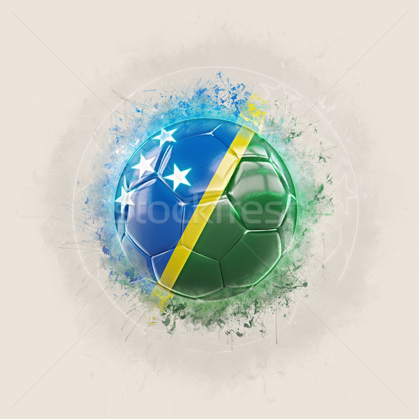 Grunge football with flag of solomon islands Stock photo © MikhailMishchenko
