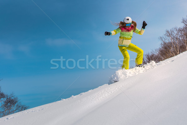 Stock photo: Happy young woman snowboard in deep snow