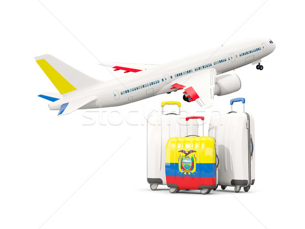 Luggage with flag of ecuador. Three bags with airplane Stock photo © MikhailMishchenko