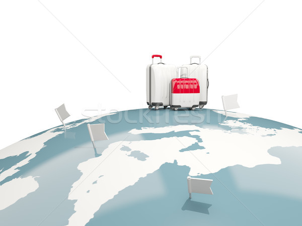 Luggage with flag of indonesia. Three bags on top of globe Stock photo © MikhailMishchenko