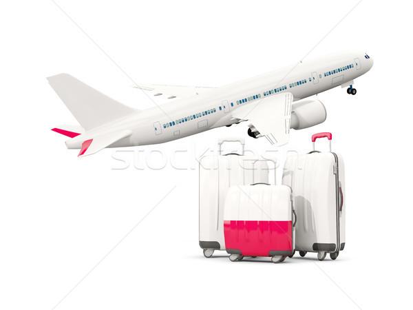 Luggage with flag of poland. Three bags with airplane Stock photo © MikhailMishchenko
