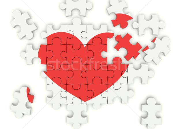 Puzzle with heart isolated on white Stock photo © MikhailMishchenko