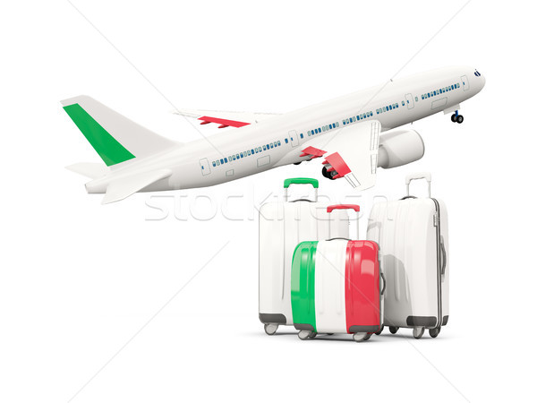 Luggage with flag of italy. Three bags with airplane Stock photo © MikhailMishchenko