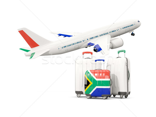 Luggage with flag of south africa. Three bags with airplane Stock photo © MikhailMishchenko