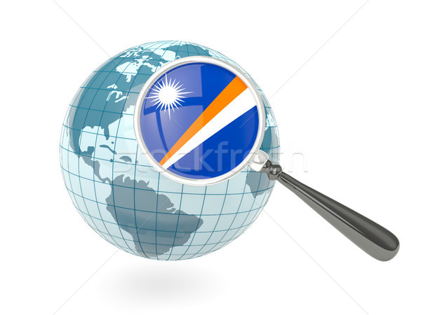 Magnified flag of marshall islands with blue globe Stock photo © MikhailMishchenko
