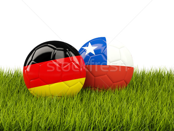 Two footballs with flags of Germany and Chile on green grass Stock photo © MikhailMishchenko