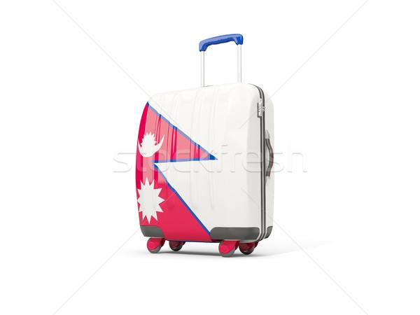 Luggage with flag of nepal. Suitcase isolated on white Stock photo © MikhailMishchenko