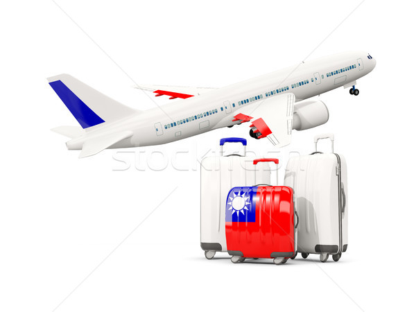Luggage with flag of taiwan. Three bags with airplane Stock photo © MikhailMishchenko