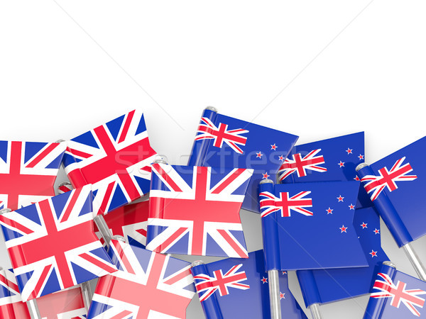 Flag pins of United Kingdom and New Zealand isolated on white Stock photo © MikhailMishchenko