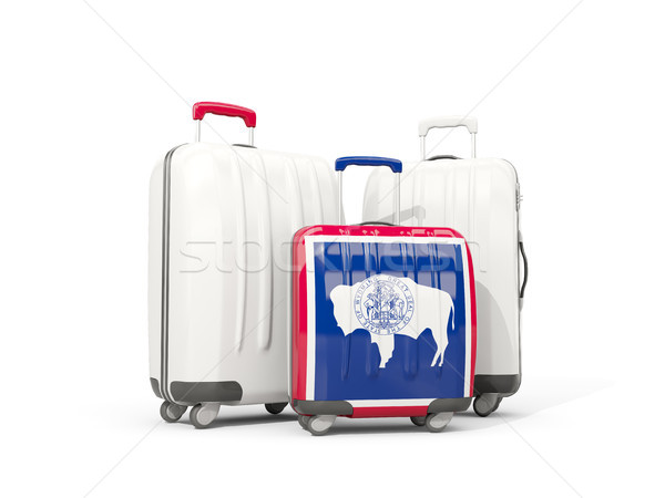 Luggage with flag of wyoming. Three bags with united states loca Stock photo © MikhailMishchenko