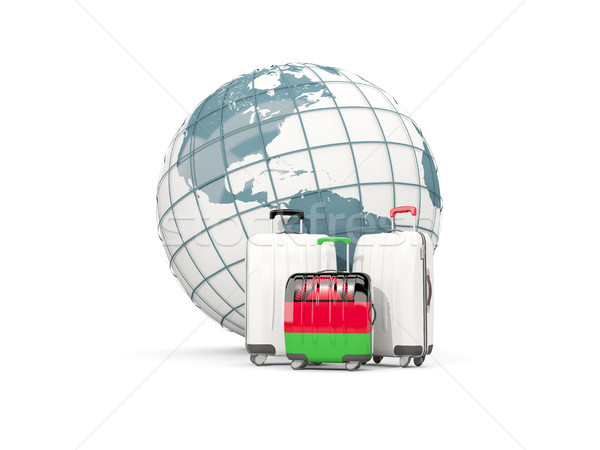 Luggage with flag of malawi. Three bags in front of globe Stock photo © MikhailMishchenko