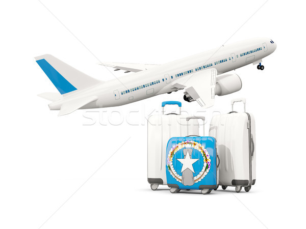 Luggage with flag of northern mariana islands. Three bags with a Stock photo © MikhailMishchenko