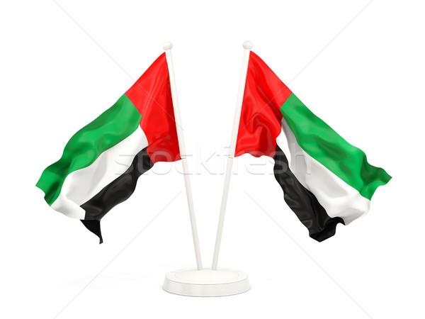 Two waving flags of united arab emirates Stock photo © MikhailMishchenko