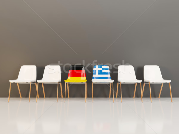 Chairs with flag of Germany and greece in a row Stock photo © MikhailMishchenko