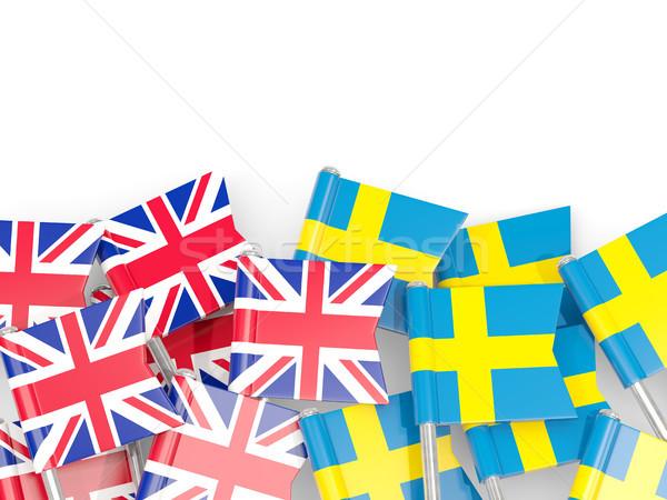 Flag pins of United Kingdom and Sweden isolated on white Stock photo © MikhailMishchenko