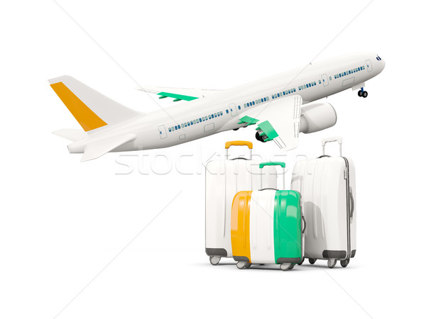 Luggage with flag of cote d Ivoire. Three bags with airplane Stock photo © MikhailMishchenko