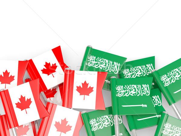 Flag pins of Canada and Saudi Arabia isolated on white Stock photo © MikhailMishchenko