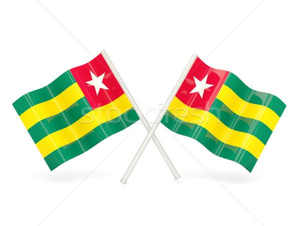 Bandiera Togo due ondulato bandiere isolato Foto d'archivio © MikhailMishchenko
