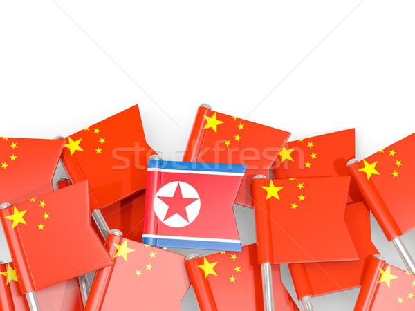 Flag pins of China and North Korea Stock photo © MikhailMishchenko