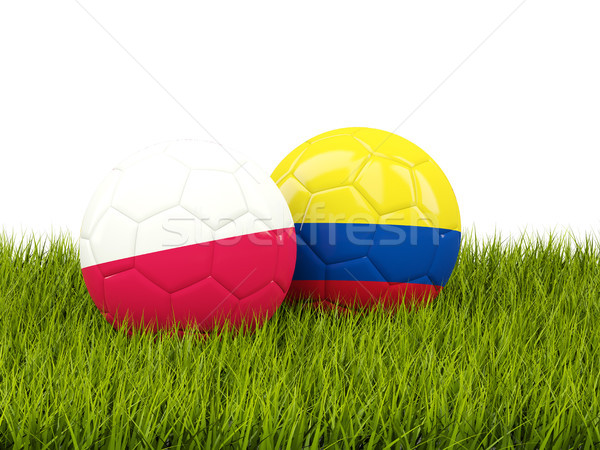 Poland vs Colombia. Soccer concept. Footballs with flags on gree Stock photo © MikhailMishchenko