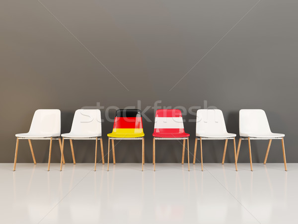 Chairs with flag of Germany and austria in a row Stock photo © MikhailMishchenko