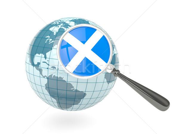 Magnified flag of scotland with blue globe Stock photo © MikhailMishchenko