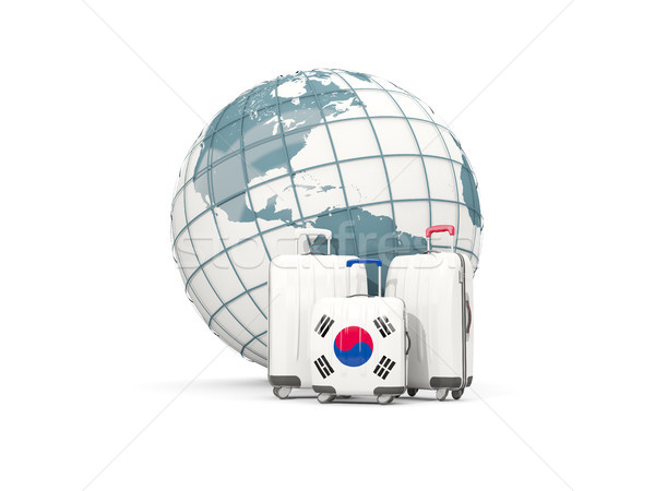 Luggage with flag of korea south. Three bags in front of globe Stock photo © MikhailMishchenko