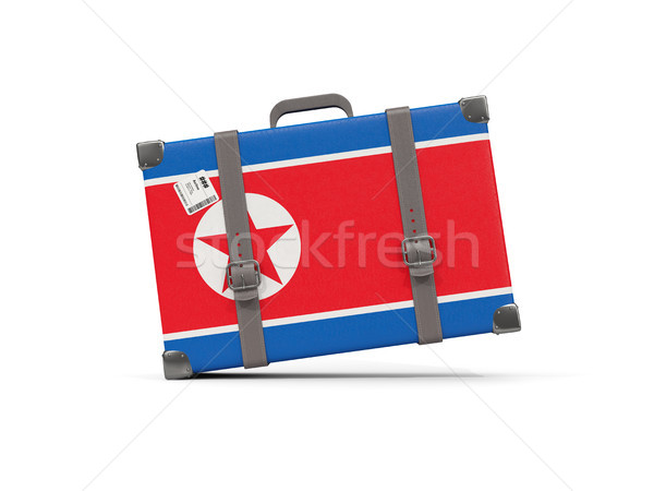 Luggage with flag of korea north. Suitcase isolated on white Stock photo © MikhailMishchenko