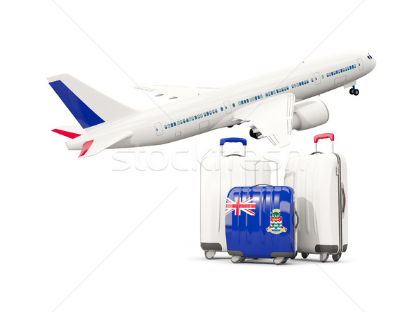 Luggage with flag of cayman islands. Three bags with airplane Stock photo © MikhailMishchenko