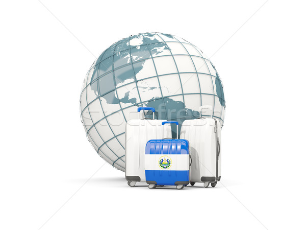 Luggage with flag of el salvador. Three bags in front of globe Stock photo © MikhailMishchenko