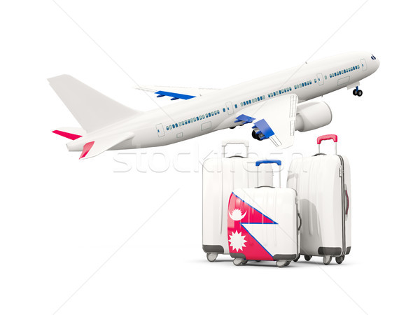 Luggage with flag of nepal. Three bags with airplane Stock photo © MikhailMishchenko