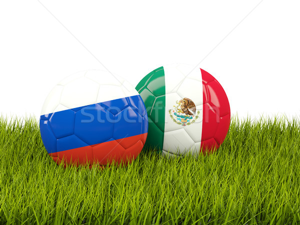 Two footballs with flags of Russia and Mexico on green grass Stock photo © MikhailMishchenko