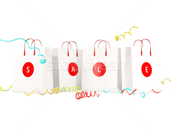 Sale and shopping concept. Paper shopping bags isolated on white Stock photo © MikhailMishchenko