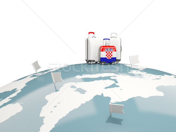 Luggage with flag of croatia. Three bags on top of globe Stock photo © MikhailMishchenko